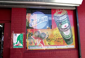Minaya Grocery, 5023 4th Ave, Brooklyn, NY with poster designs for Heineken byMaria Dominguez for Bodega Cultural NYC